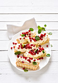 Macaroon slices with pomegranate seeds