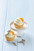 Almond muffins with vanilla mousse and tangerines