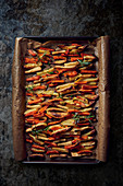 Roasted vegetables (carrots, potatoes) on a baking tray