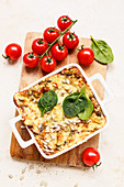 Spinach and tomato bake with cheese and sunflower seeds