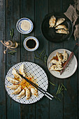 Asian dumplings Gyozas potstickers on white blue ceramic plate