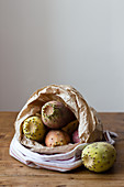 Fresh prickly pears in a paper bag
