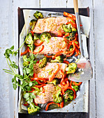 Baked oriental salmon on a baking tray
