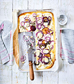 Tarte flambée with goat's cheese and plums