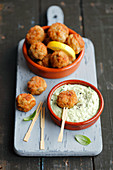 Mini pork croquettes with avocado and mayo dip