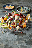 Colourful chocolate covered fruit on a cooling rack