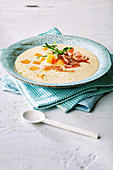 Hearty melon soup with yoghurt and parma ham