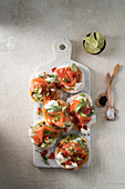 Mini pizzas with smoked salmon and creme fraiche