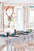 Festively set dining table in beach house
