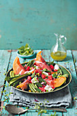 Fruity summer salad with melon, Parma ham and feta