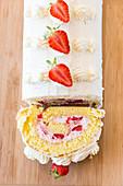 A sliced strawberry Swiss roll