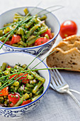 Bean salad with tomatoes and chives