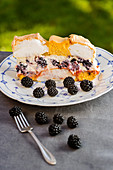 Kardinalschnitte (sponge and meringue cream slice) with blackberries