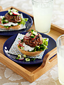 Burgers with yoghurt, radishes and cucumber
