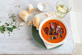 Pumpkin soup with sausage and baguette