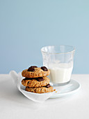 Nut biscuits with chocolate chips and a glass of milk