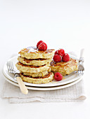 Healthy pancakes with raspberries and honey