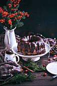 Chocolate bundt cake with chocolate ganache on a cake stand