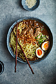 Japanese ramen with pork belly, mushrooms and marinated eggs