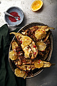 Traditional jewish and middle eastern food roasted eggplants with lemon, chili and caramelized onion