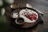 Yoghurt with homemade wild berry jam and chia