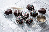 Decorated egg-shaped cake pralines with rice milk chocolate (vegan)
