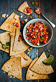 Tomato salsa with homemade taco chips (Mexico)