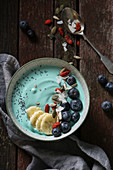 A majik blue smoothie bowl with spirulina, fruit, goji and seeds