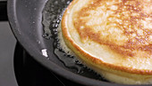 A pancake cake being made