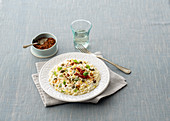 Lemon risotto with stracciatella, capers and dried tomatoes