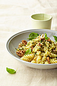 Fusilli with cheese and walnut sauce and basil
