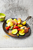 Potatoes with colourful vegetables and turmeric sauce