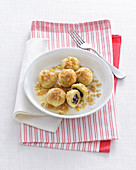 Stuffed potato dumplings with prunes and butter breadcrumbs