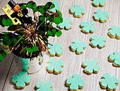Lucky charms: clover-shaped cookies and lucky clover in a pot