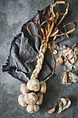 Rustic moody looking ingredient shot of a garlic plait
