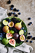 Fresh fruit platter, with figs, limes, blueberries, blackberries, and passion fruit