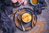 Golden milk turmeric latte served in a blue cup