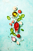 Fresh ingredients for italian or vegetarian food on blue stone background