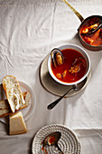 Traditional mediterranean soup bouillabaisse with mussels, shrimps, tomatoes and fish broth