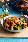 Steamed carrots and green beans with almonds