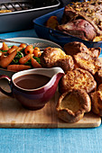 Yorkshire puddings with a gravy boat