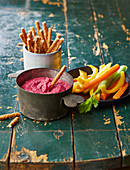 Beetroot dip with vegetable stick and bread sticks