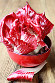 Radicchio in a red bowl (close-up)