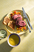 Rare beef shoulder sous vide with potato waffles