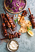 Redcurrant lamb souvlaki with super-easy flatbread