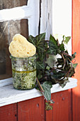 A homemade exfoliator made from leaves, olive oil and sea salt
