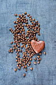 Top view of coffee beans and chocolate on grunge slate background