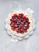 Pavlova with cream and berries for Christmas