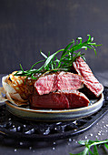 Grilled beef steaks with fresh tarragon