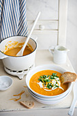 Carrot and orange soup with fresh coriander